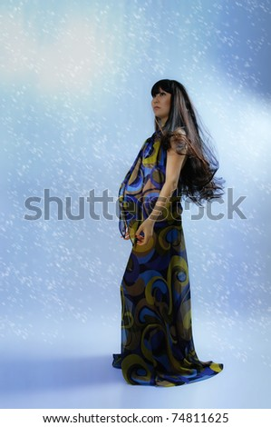 stock photo : asian pregnant woman in transparent dress on blue background ...