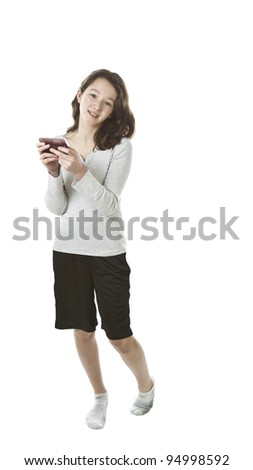 Asian Preteen girl holding cell phone in hands on white background