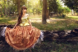 Asian princess on timber in forest, Halloween costume.