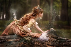 Asian princess with magic dust in forest, Halloween Christmas costume.