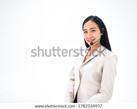 Asian professional call center woman help to support customer or client about solution by answer the question with consult via headset while working with kind and quality on isolated white background Photo stock ©