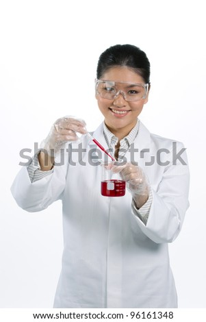 Asian scientific researcher holding a liquid solution.