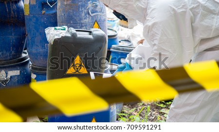 asian scientist wear chemical...