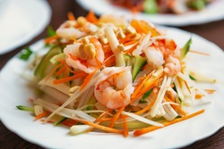 Asian sea food.Shrimp salad with raw cabbage served on white plate in Vietnamese restaurant.Fresh seafood for healthy eating.Diet nutrition,exotic cuisine with low fat & high protein.Shrimps on salads