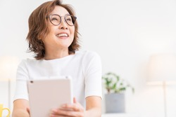 Asian senior age woman who uses tablet computer