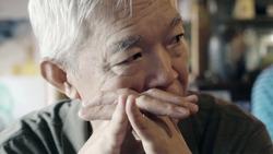 Asian senior elder man thinking about life vintage color