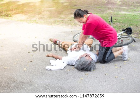Asian senior female use hand pump on chest of Asian patient man, unconscious patient treatment, cardiopulmonary resuscitation, cpr, heart attack, Acute myocardial infarction