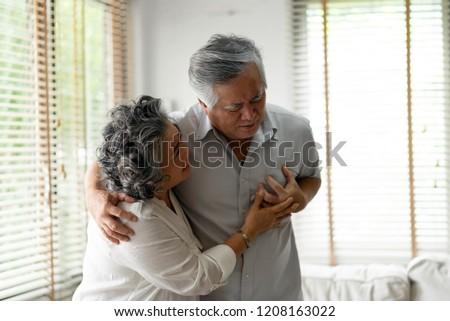 Asian Senior male having heart attack.
