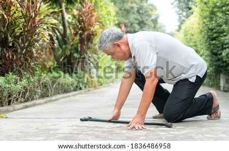 Asian senior man falling down at home in the backyard caused by myasthenia (Muscle Weakness) and the nurse came to help support. Concept of old elderly insurance and health care Stock photo ©
