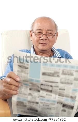 Asian senior man reading newspaper on white background