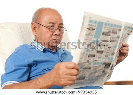 Asian senior man reading newspaper on white background