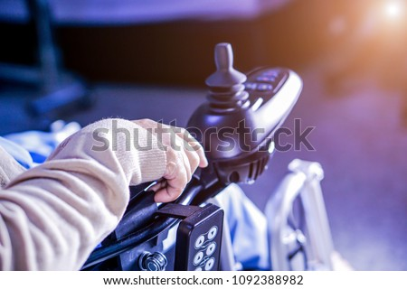 Asian senior or elderly old lady woman patient on electric wheelchair with remote control at nursing hospital ward : healthy strong medical concept   Photo stock ©