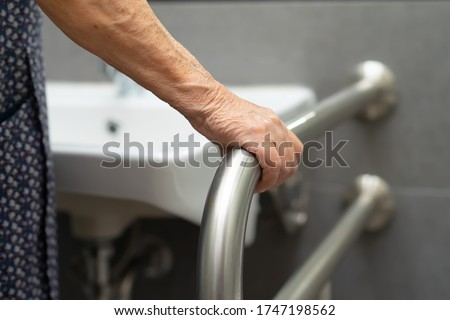 Asian senior or elderly old lady woman patient use toilet bathroom handle security in nursing hospital ward : healthy strong medical concept. Photo stock ©