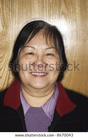 Asian senior woman with ringflash
