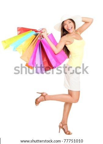Asian shopping woman happy smiling holding many shopping bags. Asian shopper girl isolated on white background in full length wearing summer hat.