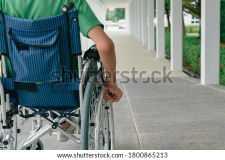 Asian special child on wheelchair wearing green shirt learn how to use wheelchairs on ramps for people with disabilities,Lifestyle in the education age of disabled children,Happy disabled kid concept. Stockfoto ©