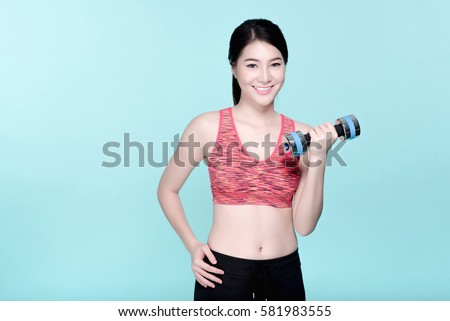 7062457569 Asian sport girl workout with dumbbell. Beauty face and natural makeup  sports bra outfit.
