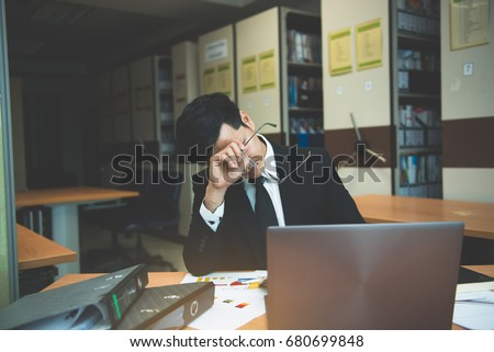 Asian stress business man working fail,The owner of the company blamed him with bad word,Thai employee serious from hard work from boss,Sad handsome guy in black suit