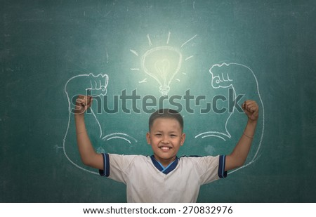 asian strong children against blackboard in classroom, Education concept