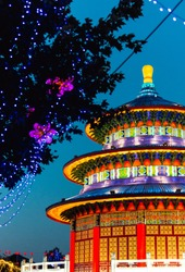 Asian structure illuminated with lights at festival