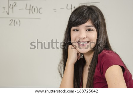 Asian student in classroom/Brilliant Asian Student/Young attractive Asian student in classroom setting