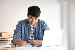 Asian student preparing for exam at home