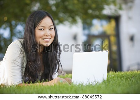 Asian Student Studying on Laptop Computer