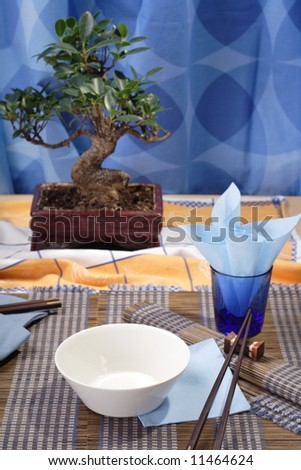 Asian style decorated table, soup bowl in the foreground