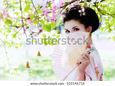 Asian style portrait of young woman in the garden