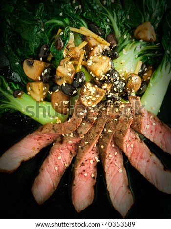 Asian styled grilled steak with bok choy and mushrooms in black bean sauce