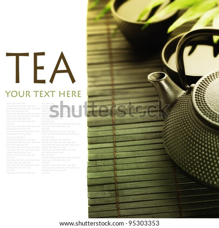 Asian tea set on bamboo mat(Green tea, palm leaf and chopsticks) with sample text - stock photo