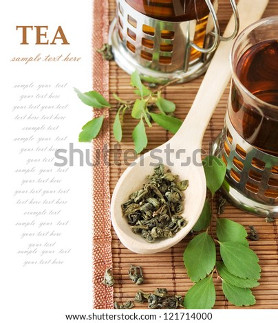 Asian Tea (still life with tea, cup of tea,green leaves and bamboo mat isolated on white background with sample text)