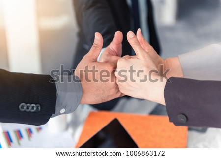 Asian team business and partners business giving thumbs up together after meeting complete. Business concept - Shutterstock ID 1006863172