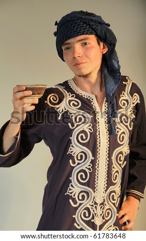 Asian Teatime, an Asian man with a cup of tea