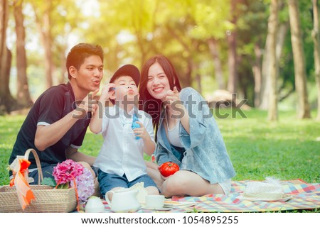 Asian teen family happy holiday picnic moment in the park #1054895255
