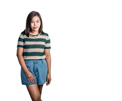Asian teenage girl 24-megapixel, 24-megapixel jpg, standing shirt, green and white stripes, standing jeans, smiling isolated from the background jpg