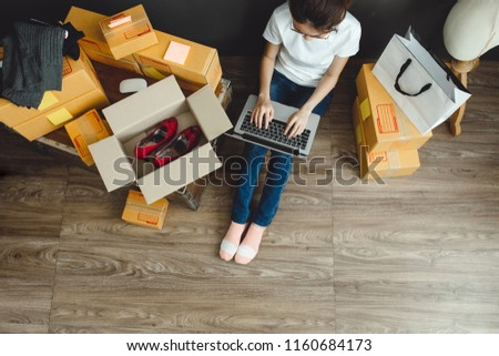Asian teenager owner business woman work at home for online shopping and sale. #1160684173