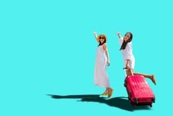 Asian tourism girls in white casual with travel bag happy smiling in summer, isolate on vibrance background