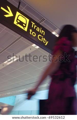 Asian tourist at airport rushing