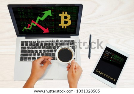 Asian Trader women research cryptocurrency information especially bitcoin for stock trade and invesment