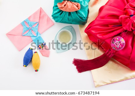 Asian traditional gift box on Silk background and color