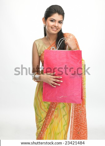 Asian traditional girl with sari carrying shopping bags - stock photo