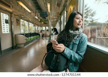 Young Asian girl on the subway , Japan Images and Stock Photos