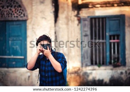 Asian Traveler wearing Blue Plaid Shirt Taking a Photo with Film Camera for Travelling in Bangkok , Thailand -  Relax Lifestyle Travel in Hollidays #1242274396