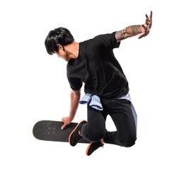 Asian urban man jumping with skate