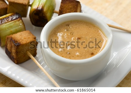 Asian vegetarian skewers made from mushrooms, tofu and leek