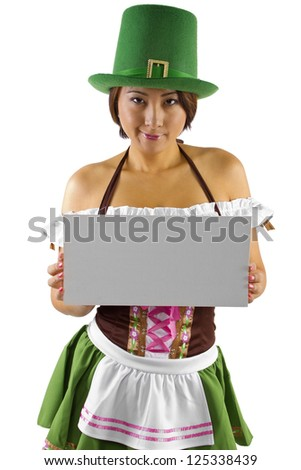 Asian waitress in a St Patricks Day costume holding a sign.