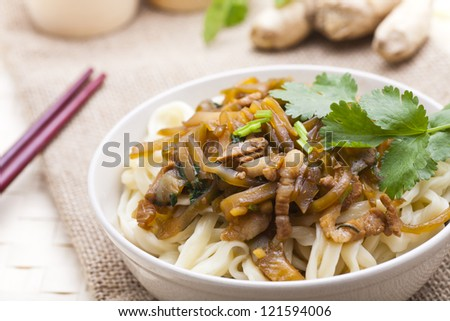 Asian wheat noodle with chopsticks.