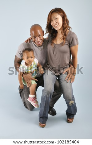 stock photo asian wife african american husband their mixed race infant girl
