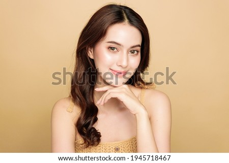 Asian woman are happy with perfect clean healthy skin and beautiful long brown hair. Cute female model clean fresh skin . Expressive facial expressions. Cosmetology, Skincare, Beauty face concept.